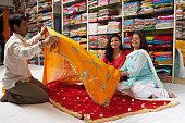 Women selecting sari in sari shop