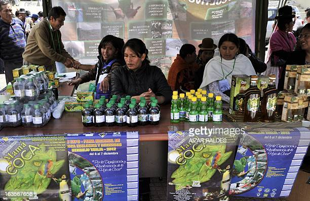 Women sell drinks and other products made out of coca leaves