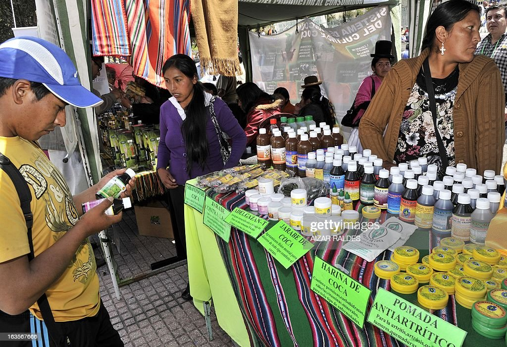 Women sell drinks and other products made out of coca leaves at a stall in a square of La Paz, on March 12, 2013 during the celebration of the first National year of Coca Chewing (acullicu). AFP PHOTO/Aizar Raldes