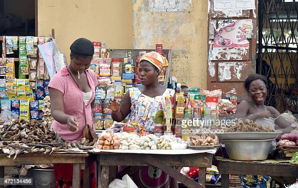 Women sell food and spices at a market in Lome on April 25 2015 AFP PHOTO / ISSOUF SANOGO