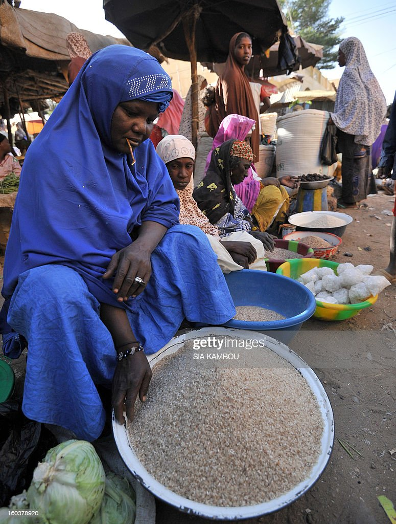Women sell rice on January 30, 2013 at a market in the northern city of Gao, a key Islamist stronghold until it was retaken on January 26 by French and Malian troops in a major boost to the French-led offensive against the Al Qaeda-linked rebels, who have been holding Mali's vast desert north since last April. French troops on January 30 entered Kidal, the last Islamist bastion in Mali's north after a whirlwind Paris-led offensive, as France urged peace talks to douse ethnic tensions targeting Arabs and Tuaregs. AFP PHOTO/ SIA KAMBOU