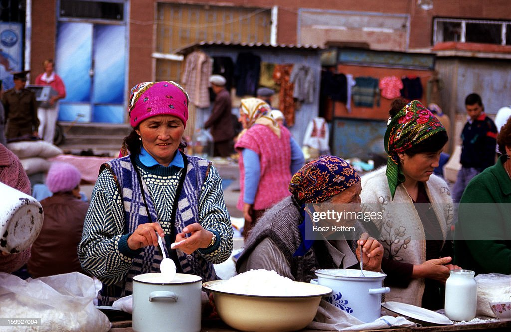 CONTENT] Women selling fresh yoghurt in a colorful market in Kyrgyzstan.
