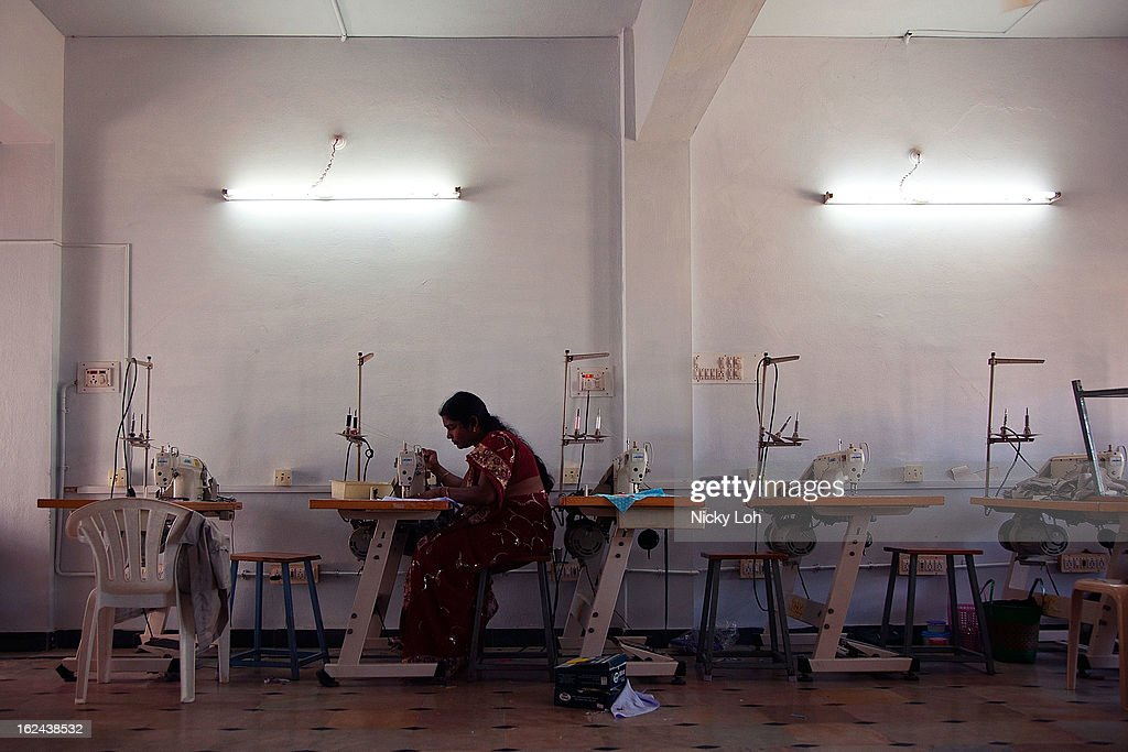 Women sew textile products at the Aarti Home shelter on February 21, 2013 in Kadapa, India. A Singapore based charity group called, Daughters of Tomorrow, is giving women in India meaningful work and valuable income by retailing their products in first world countries.