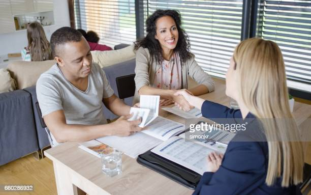 Women shaking hand with insurance agent