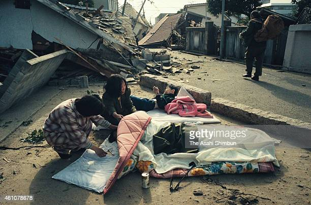 Women shed tears as a body of their family is recovered from the debris on January 17 1995 in Ashiya Hyogo Japan Magnitude 73 strong earthquake...