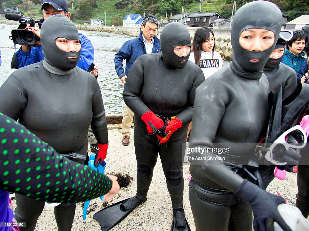 Women shell divers called 'Ama' gather at the port to release baby shells as a part of the Ama Summit 2013 in Wajima on October 26, 2013 in Wajima, Japan. During the Ama Summit 2013 in Wajima, women shell divers talked about issues such as the impact from the earthquake in 2011 as well as shortage of successors in panel discussion.