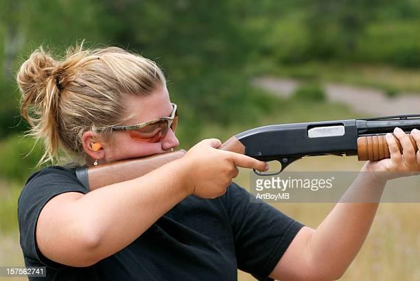 Women shooting shotgun