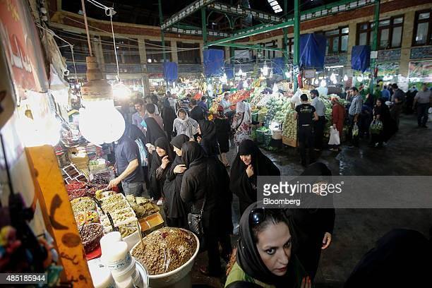 Women shop at grocery stalls inside the Tajrish bazaar in Tehran Iran on Sunday Aug 23 2015 Iran the world's fifth largest crude producer has set...