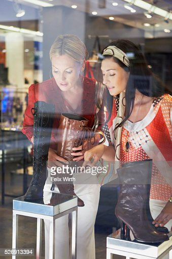 Women shopping for boots : Stock Photo
