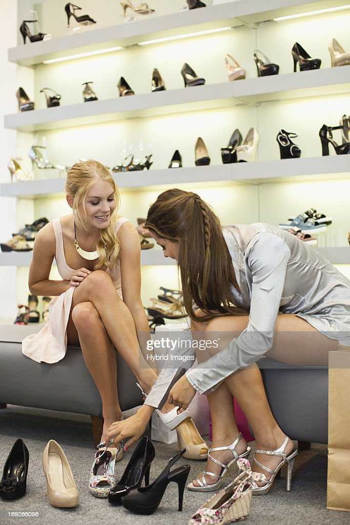 Women shopping for shoes together