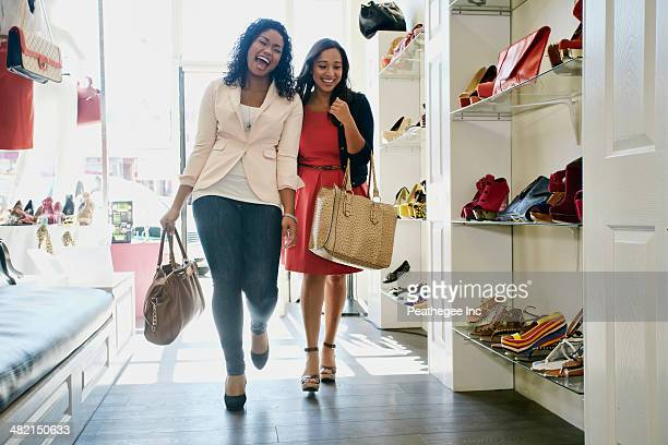 Women shopping together in shoe store