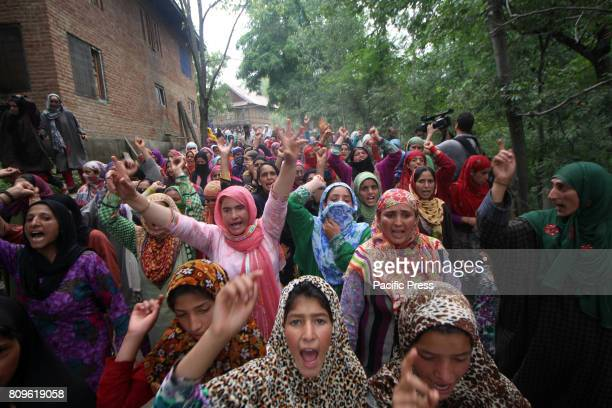 Women shout pro freedom slogan during the funeral prayers of Jehangir Ahmad Khanday of Keller area of Shopian district Six homes were destroyed...