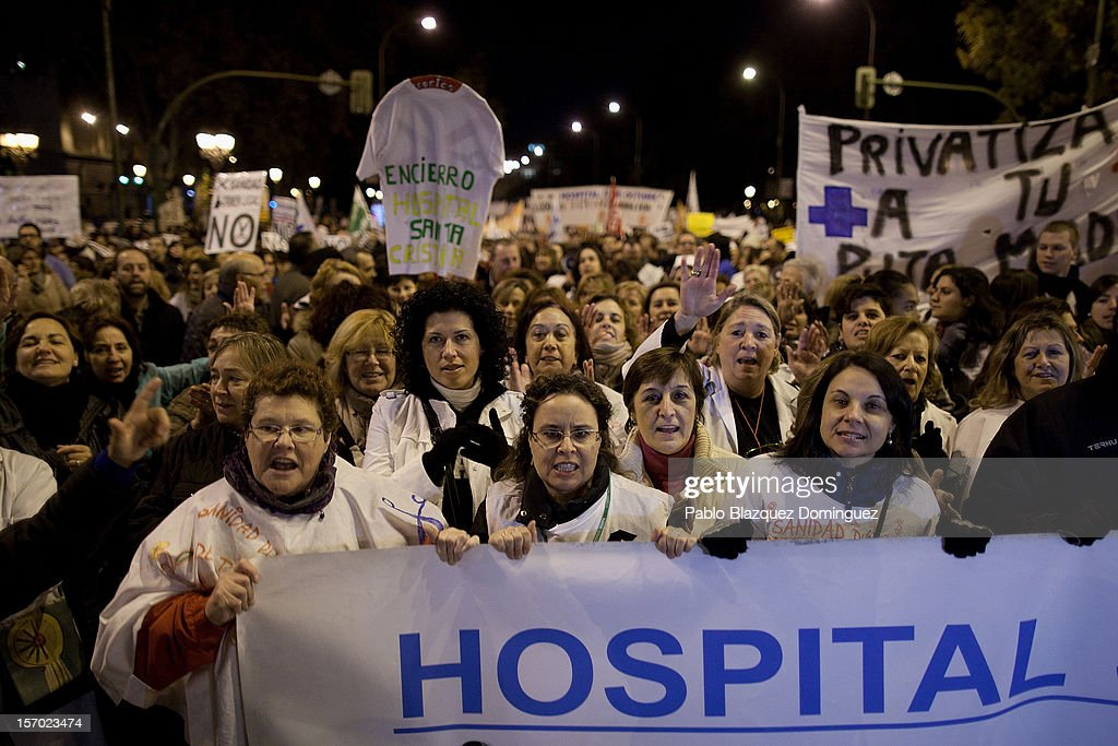 Women shout slogans amid other health workers during a demonstration held on the second day of a two-day general strike on November 27, 2012 in Madrid, Spain. For the first time all trade unions called for a 48-hour general health workers strike in the Madrid region after the regional government announced severe cuts and privatization of medical centers.