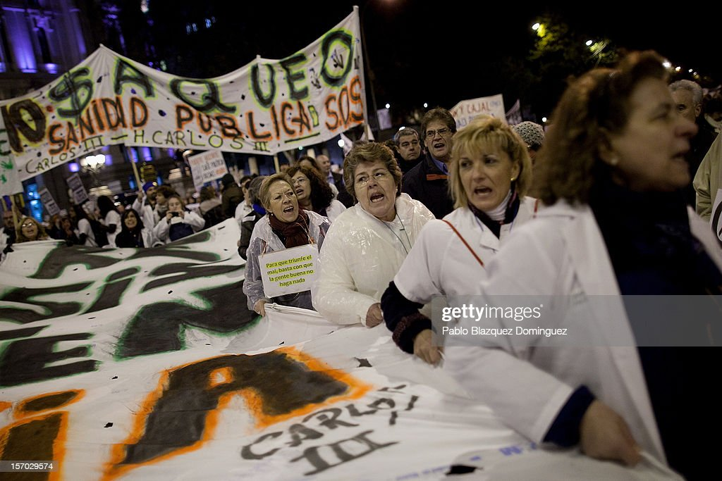 Women shout slogans amid other health workers during a demonstration held on the second day of a two day general strike on November 27, 2012 in Madrid, Spain. For the first time all trade unions called for a 48-hour general health workers strike in the Madrid region after the regional government announced severe cuts and privatization of medical centers.