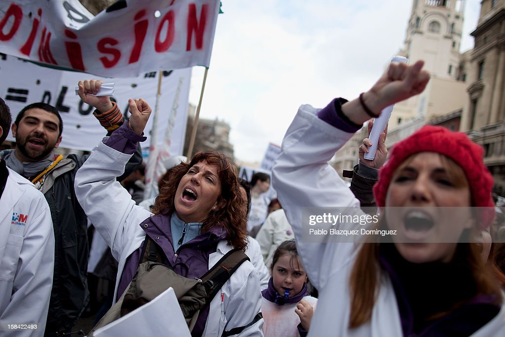 Women shout slogans amid other health workers during a demonstration against cuts on public health care and the privatization of medical centers and hospitals on December 16, 2012 in Madrid, Spain. In Madrid, doctors have already staged 11 days of strikes and all health workers unions are calling for a third 48 hour strike on December 19 and December 20. Around 4,000 operations have been suspended in Madrid since the medical strikes started.