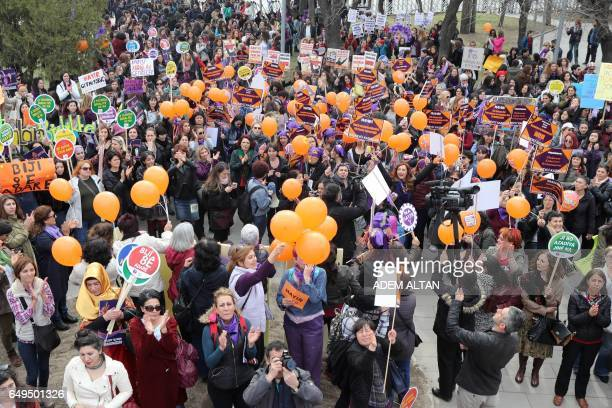 Women shout slogans and hold banners as they demonstrate in central Ankara to commemorate International Women's Day on March 8 2017 / AFP PHOTO /...