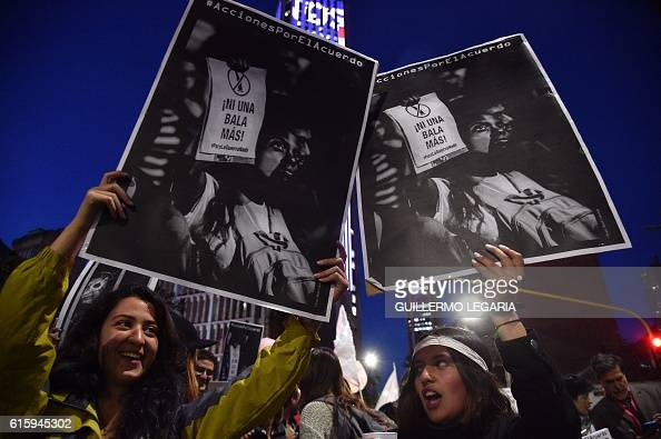 Women shout slogans during a march for peace in Bogota on October 20 2016 Colombian President Juan Manuel Santos winner of this year's Nobel Peace...
