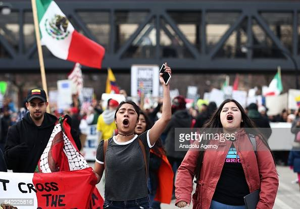 Women shout slogans during a rally against US President Donald Trump's order and his recent policies regarding cracking down on immigrants at Union...