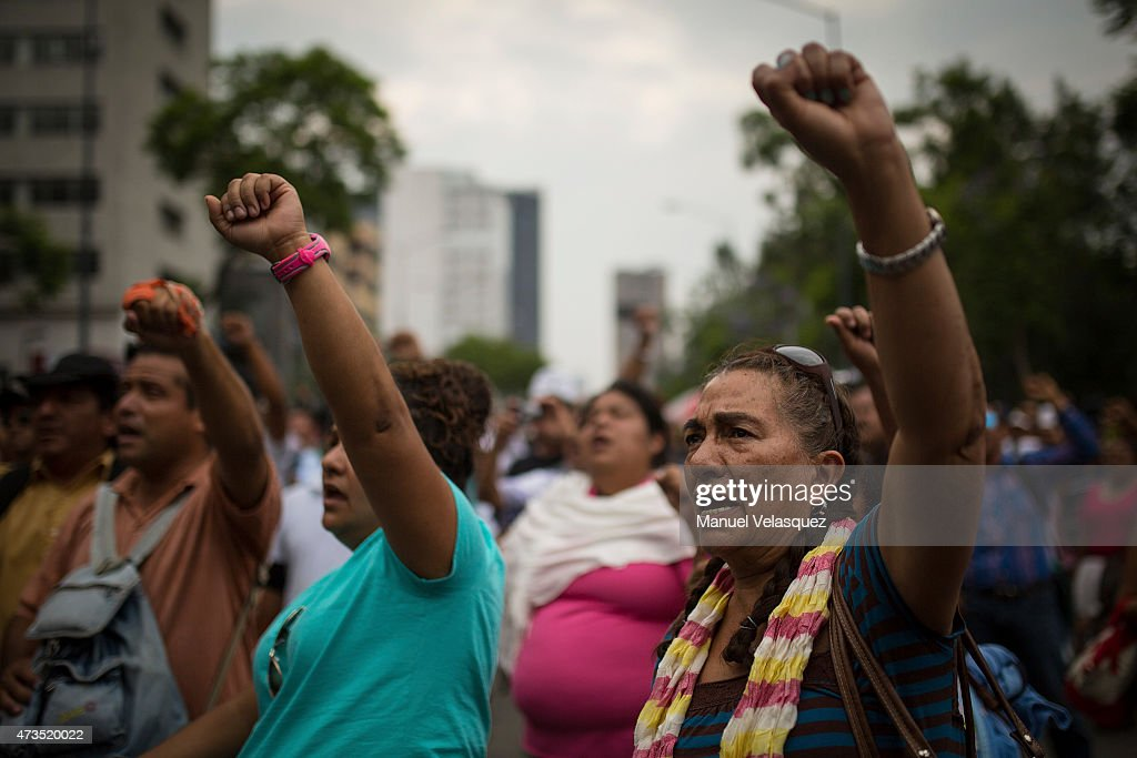Women shout slogans during the protest of the Teacher's Day in Mexico on May 15 2015 in Mexico City Mexico
