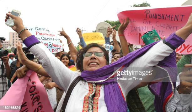 Women shout slogans outside the District court in Saket as they call for the death penalty of the four men convicted of rape and murder on September...