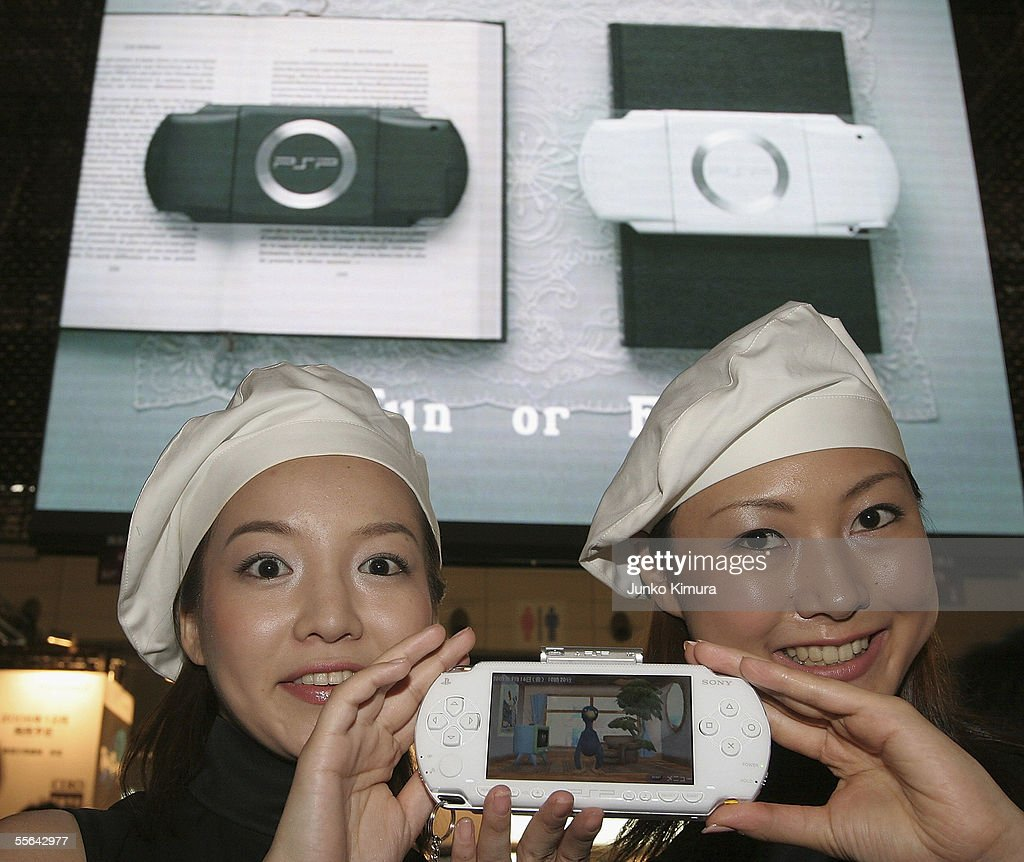 Women show off the newly released white-coloured PSP (PlayStation portable) during the Tokyo Game Show 2005 on September 16, 2005 in Chiba, Japan. The show which takes place from September 16 for 3 days is expected to attract 150,000 visitors.
