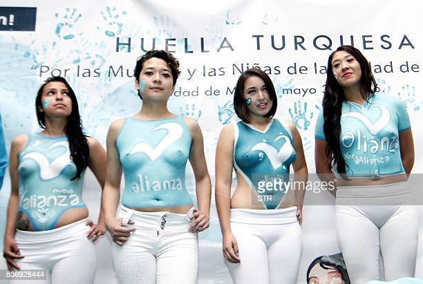 Women show their bodypaintings during the closing campaign of the 'Partido Nueva Alianza' party in Mexico City on May 31 2016 Girls with tight white...