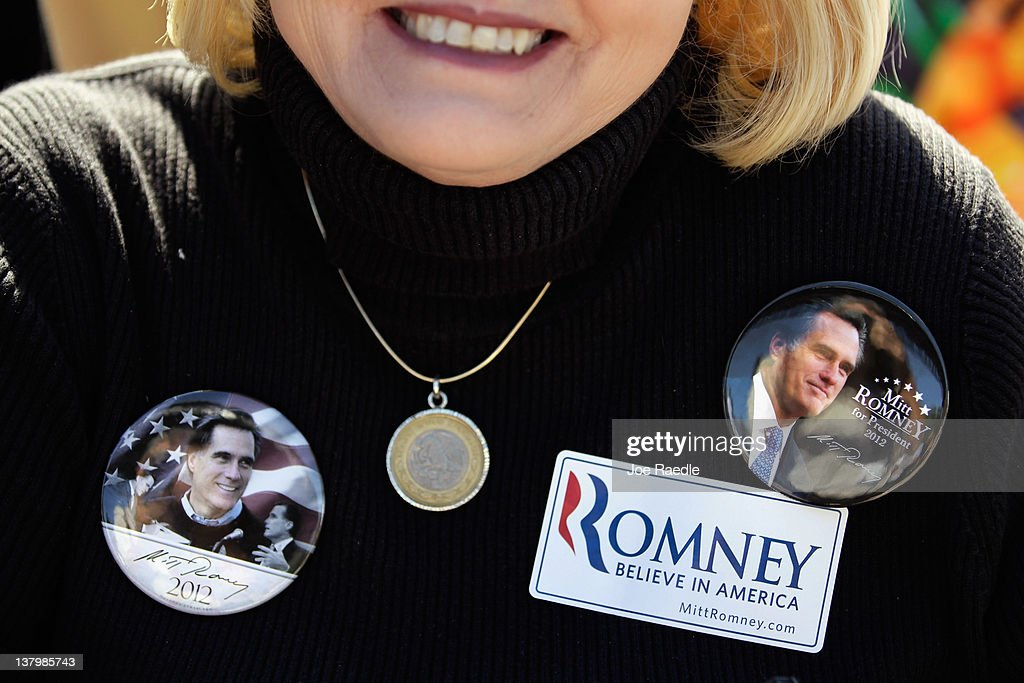 A women shows her suppport for Republican presidential candidate and former Massachusetts Gov. Mitt Romney during his rally with supporters at Pioneer Park on January 30, 2012 in Dunedin, Florida. Romney is campaigning across the state ahead of the January 31 Florida primary.
