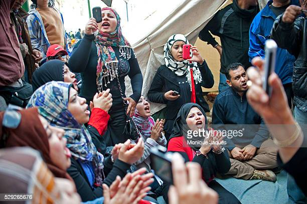 Women sing along to patriotic songs while filming with cellphones on November 25th 2011 Increasing tension bubbled over in Egypt a week before the...