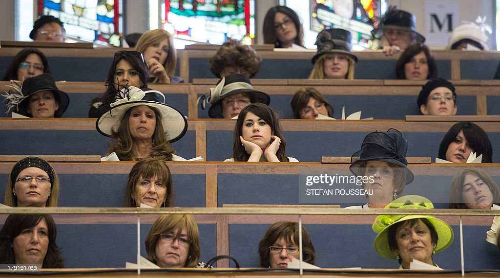 Women sit apart from the men as they attend the Installation of Chief Rabbi Ephraim Mirvis as the 11th Chief Rabbi of the United Hebrew Congregations of the UK and the Commonwealth during a ceremony at the St John's Wood Synagogue in north London on Spetember 1, 2013. AFP Photo / POOL / STEFAN ROUSSEAU
