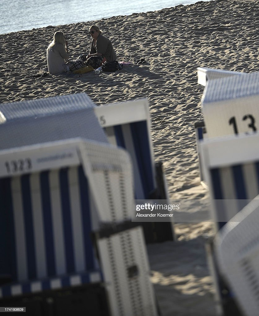 Women sit at dusk on Brandenburger Beach on July 21, 2013 in Westerland, Germany. The weather forecast for the next three days predicts sunny weather with heights of 30¡ Celsius for the north of Germany.