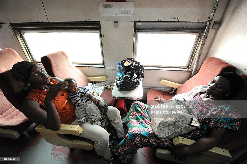 Women sit in an air-conditioned first class train coach linking Lagos to Kano on February 8, 2013. The state-owned corporation which went into bankruptcy during the last 20 years due to lack of maintenance of infrastructure and high numbers of employees also began haulage of petroleum products from Lagos to the north of the country. Earlier last year, the Railway Corporation had acquired 20 pressurised tank wagons as it prepared to commence the fuel haulage. The 20 wagons have the capacity to lift 900,000 litres of petroleum products, the equivalent of 27 road tankers.