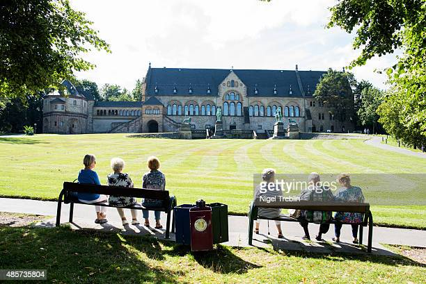 Women sit in front of Kaiserpfalz Imperial Palace on August 29 2015 in Goslar Germany Goslar town Mayor Oliver Junk has been outspoken in seeing...