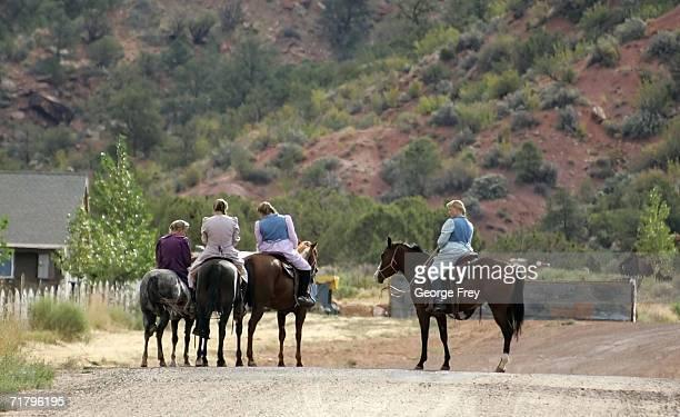 Women sit on horses September 6 2006 in Colorado City Arizona Warren Jeffs of the Fundamentalist Church of Jesus Christ of Latter Day Saints is the...