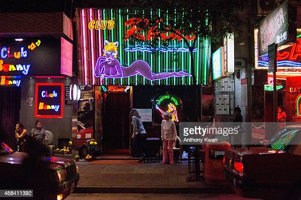 Women sit outside of a bar in Wanchai district on November 5 2014 in Hong Kong British Banker Rurik Jutting is charged with in connection with...