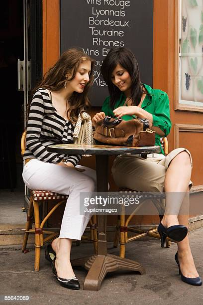 Women sitting at table of outdoor cafe