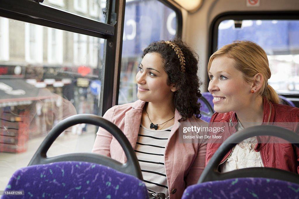 Women sitting in bus, looking outside. : Stock Photo