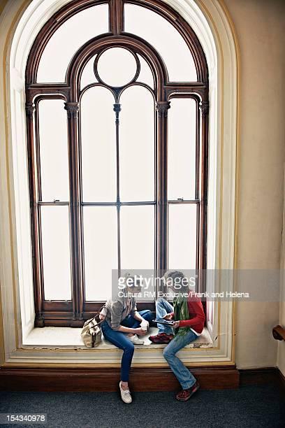 Women sitting in ornate window