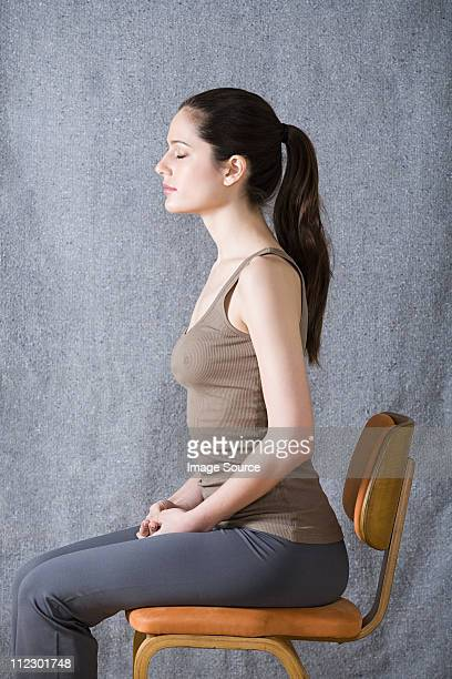 Women sitting on chair, eyes closed