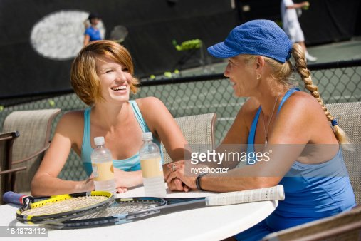 women sitting outside tennis club
