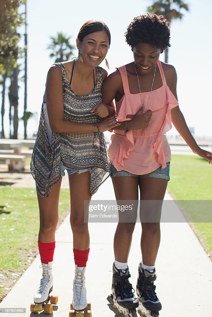Women skating together in park : Stock Photo