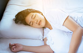 Female sleeping on the bed and grinding teeth,Female tiredness and stress