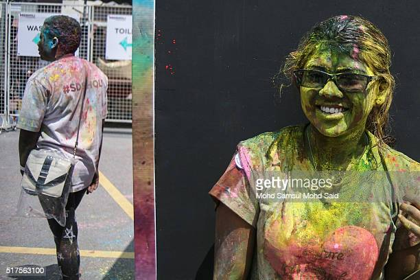 A women smile as her face covered in coloured powder during Holi festivals at a temple on March 26 2016 in Kuala Lumpur Malaysia Holi also known as...