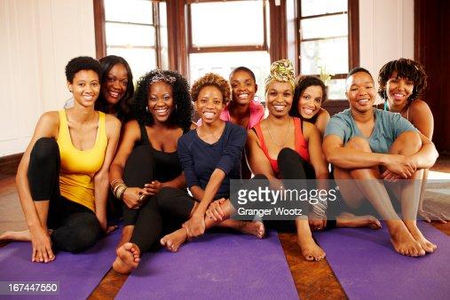 Women smiling in yoga class : Stock Photo