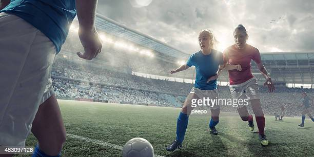 Women Soccer Players in Mid Match Action