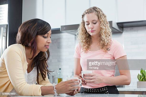 Women Social Friends Talking Seriously in Home Kitchen