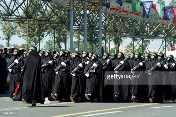 A women soldiers unit parades on September 24 1995 in front of Iranian President Ali Akbar AchemiRafsandjani and Iranian armed forces officials...