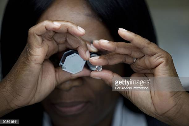 A women sorts raw diamonds at the new Diamond Trading Company the world's largest and most advanced diamondsorting and valuing facility on September...