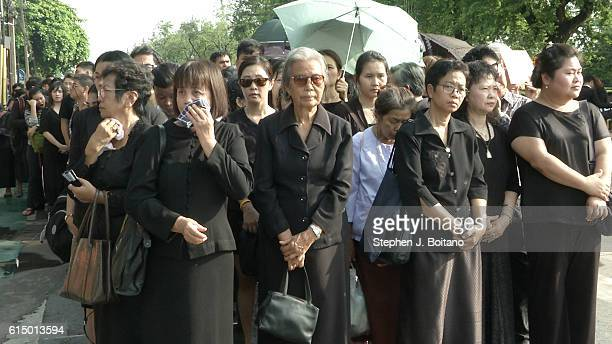 Women stand at the front of the line at the Grand Palace to pay respects to the late King Bhumibol Adulyadej in Bangkok Thailand Thailand's King...