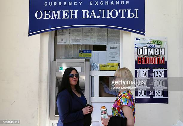 Women stand in front of a currency exchange office of Russian bank in May 9 2014 in Sevastopol Crimea Ukrainian banks have closed their branches in...