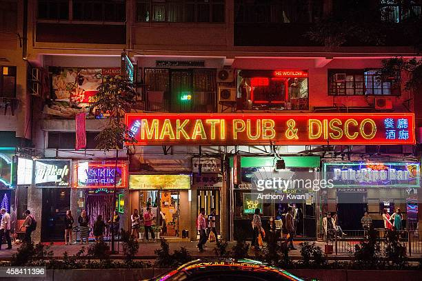 Women stand outside of bars in Wanchai district on November 4 2014 in Hong Kong British Banker Rurik Jutting is charged with in connection with...
